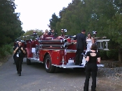 Bride and groom on firetruck during their wedding in Chico California.