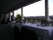 Table setup and view east from a elevated Georgetown California winery during wedding.
