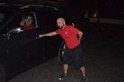 Valet pulling up car, having fun posing with another valet. Granite Bay California