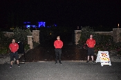 Valet parkers posing for a picture at night outside private residence. Granite Bay California